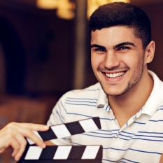 web-size-male-actor-with-clapperboard-in-front.jpg